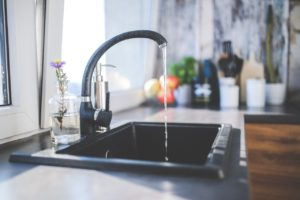 kitchen tap turned on running drinking water