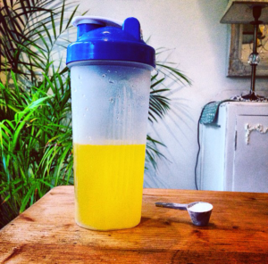 Shaker and serving scoop with BCAA's Branch Chain Amino Acids